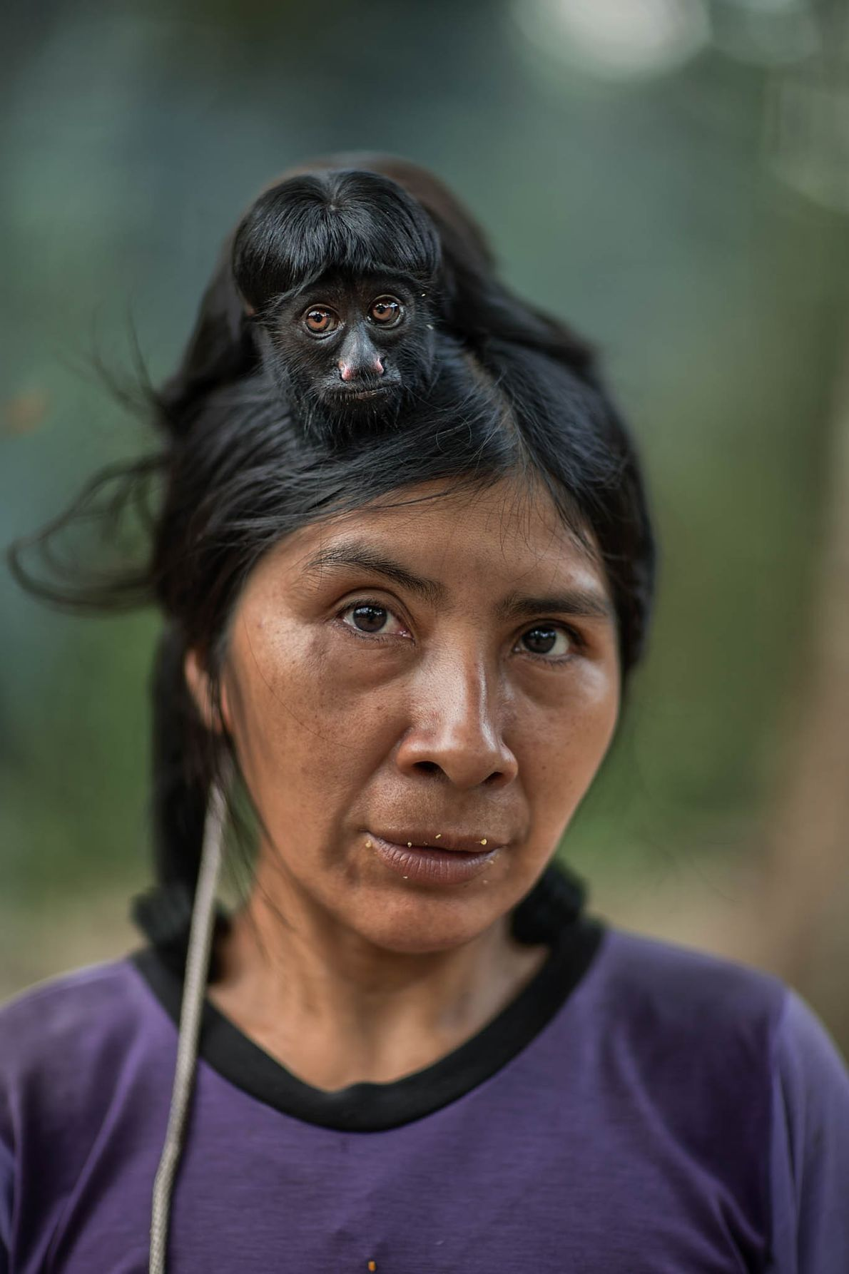 Ayrua, 39, with her pet black-bearded saki, was contacted by indigenous affairs agents in 1989. Awá ...