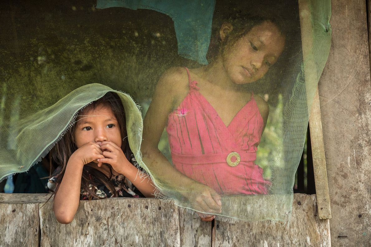 These two Huni Kuin girls live in the remote community of Curanjillo, whose farms are occasionally ...