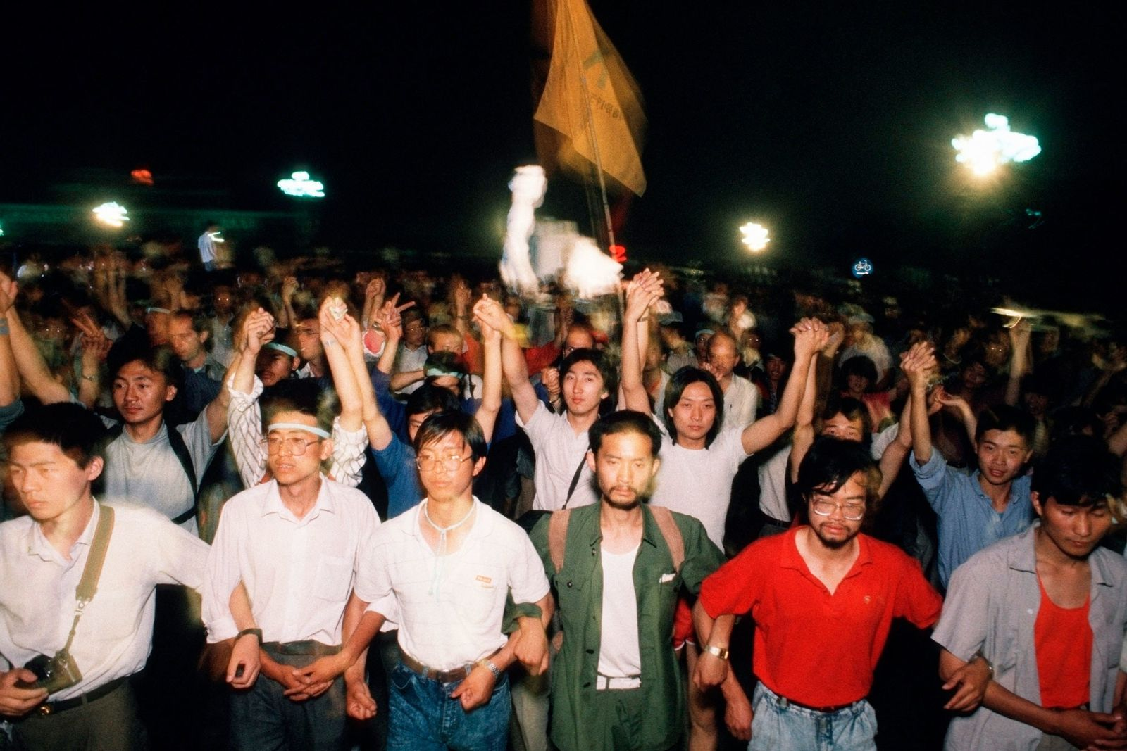 Pro-democracy students march through Tiananmen Square in Beijing to demand more democratic rule in Communist China.