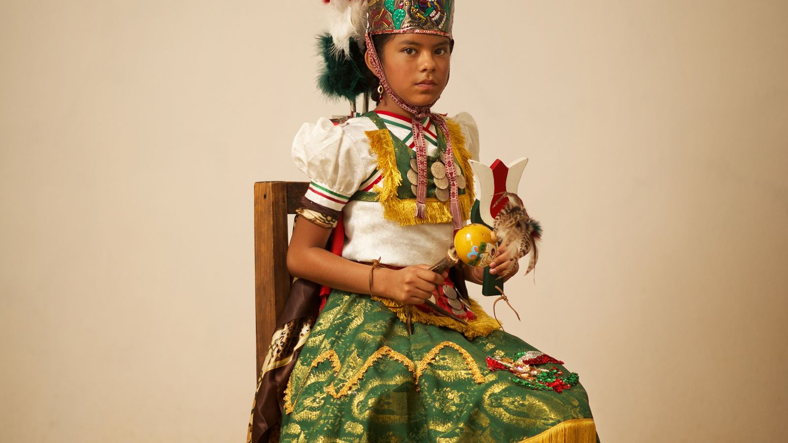 A girl represents the role of Malinche, a historical figure who eventually helped the Spaniards communicate ...