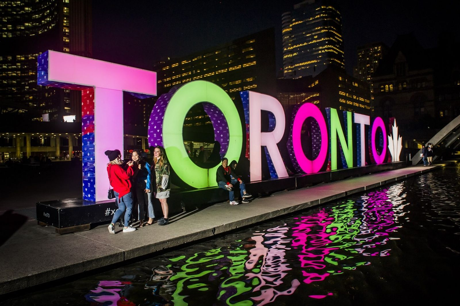The illuminated 3D TORONTO sign at Nathan Phillips Square is one of Toronto's most photo-worthy spots.