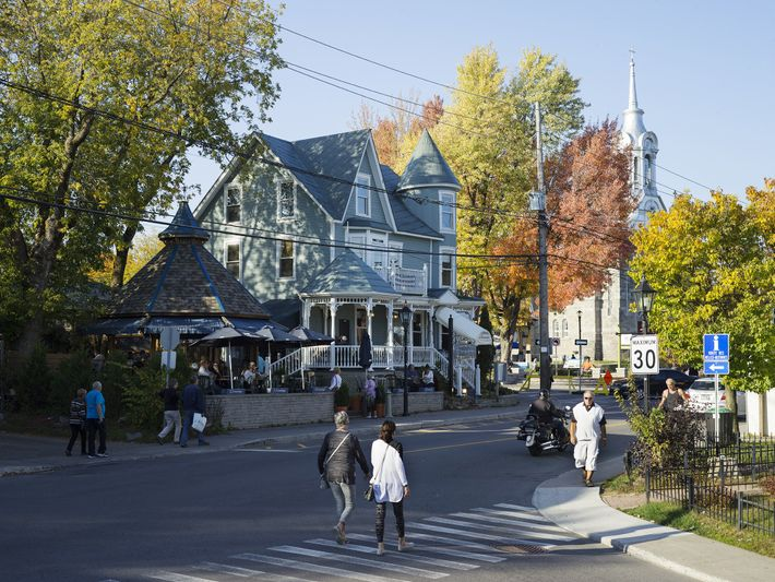 People walk down the street in Saint-Sauveur, a town not far from Montreal and a popular ...