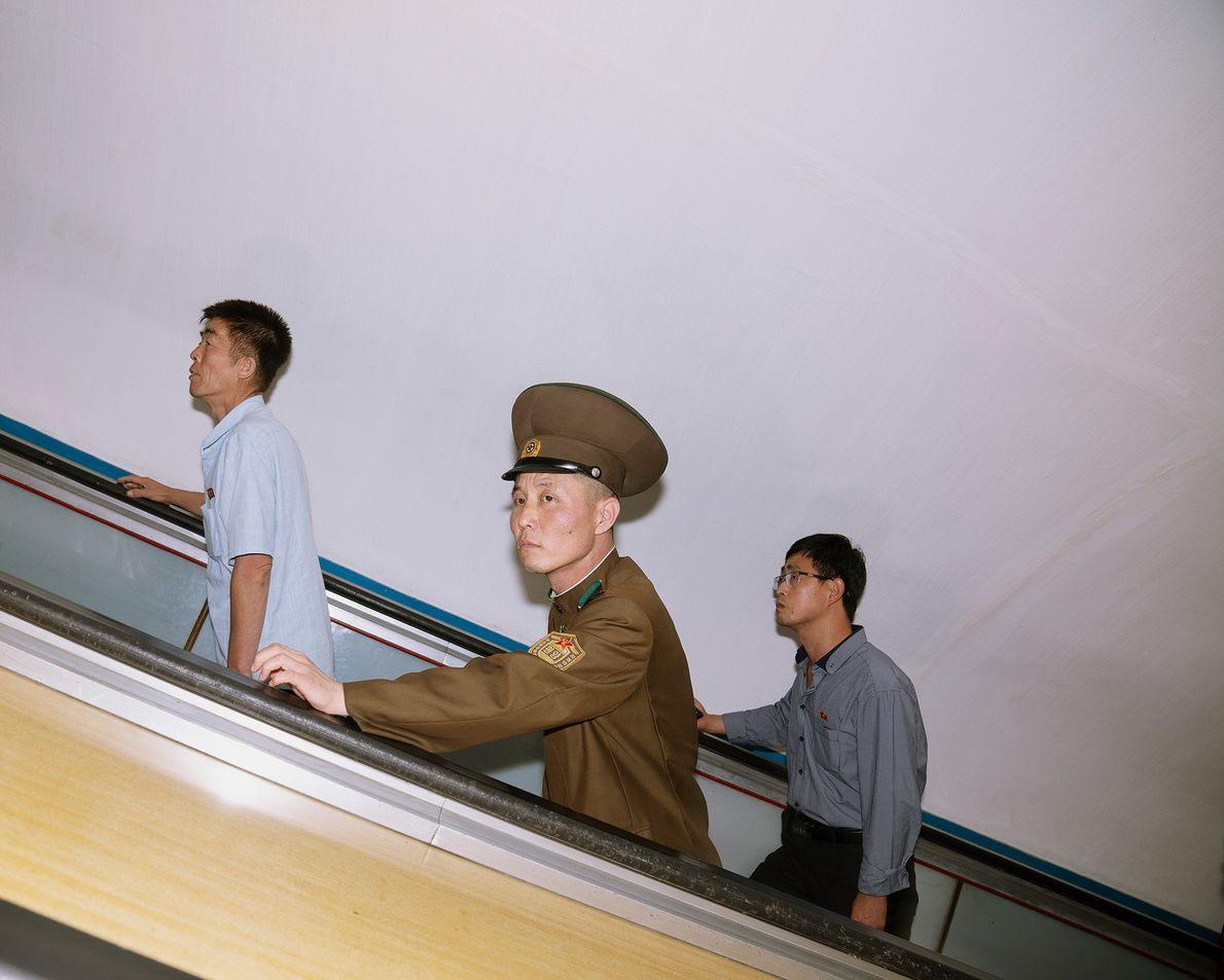 Commuters take an escalator in the Pyongyang metro.