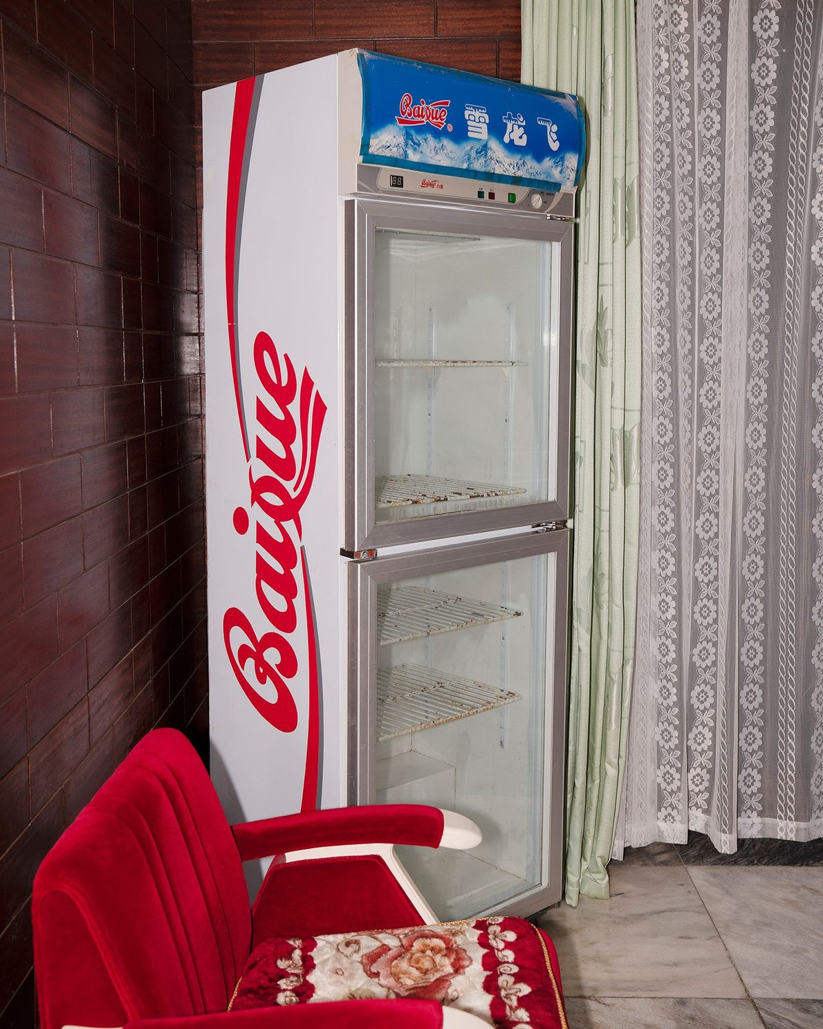 An empty cooler sits in the corner of a hotel in Nampo, North Korea.