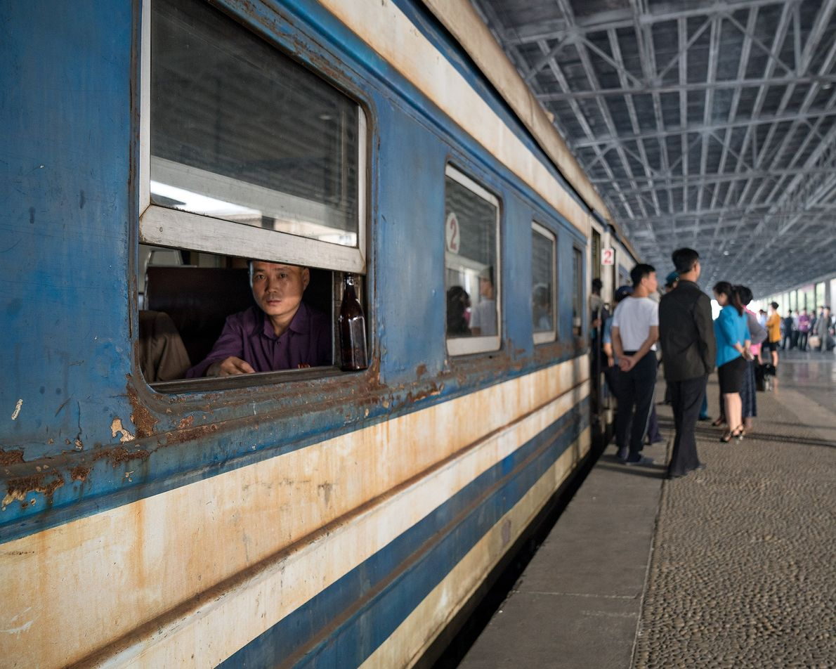 People gather on the platform in the Pyongyang train station.