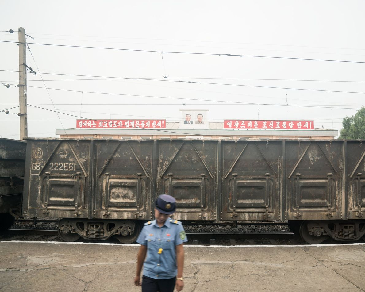 The train passes a stark railcar on the route to Rason, which is situated near the ...