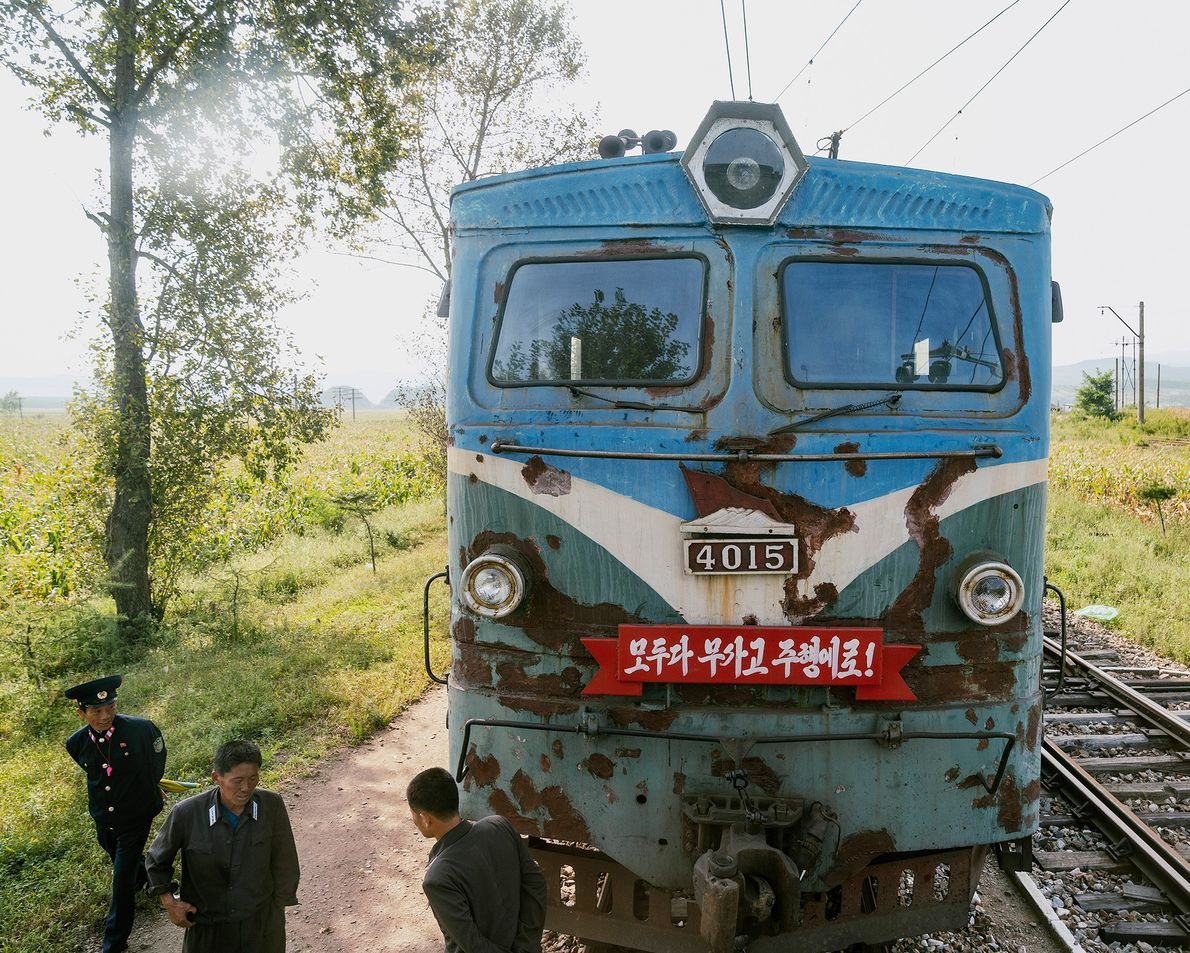 A locomotive sits on the track approaching Rason.