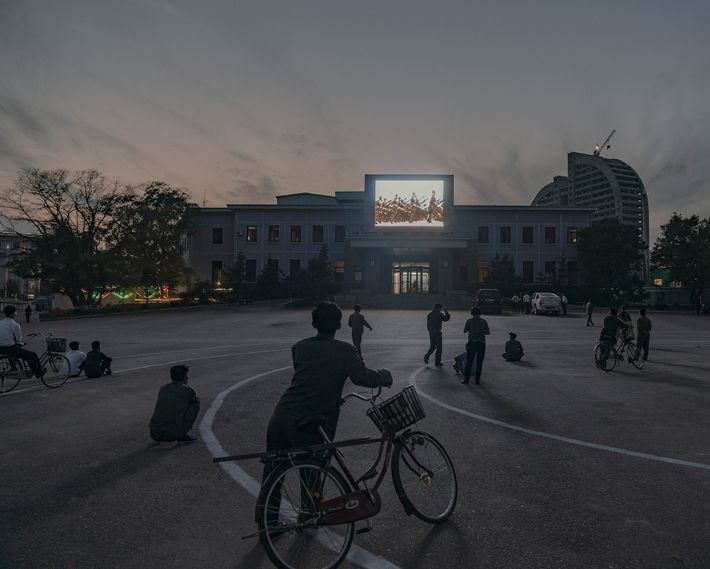 A video illuminates Rason central square at sunset.