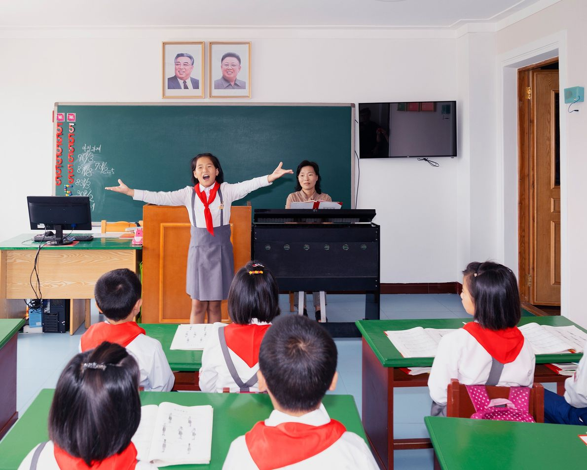 Children participate in classroom activities at an orphanage in Rason.