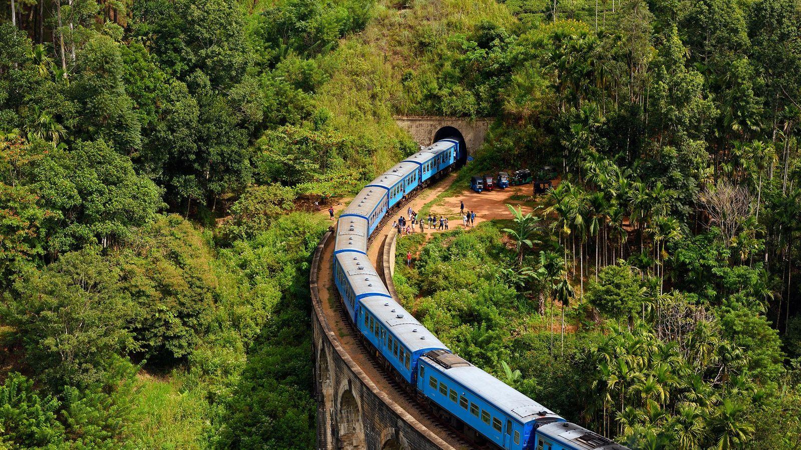 A train near Ella, Sri Lanka, cuts through the highlands and crosses the Nine Arches Bridge.
