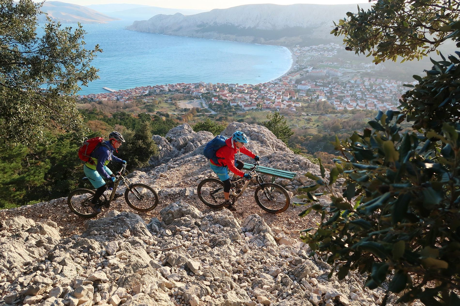 On the Trans Dinarica, cyclists soak in the view of the Croatian island of Krk.  ...