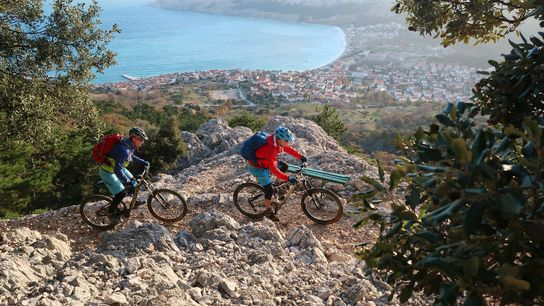 On the Trans Dinarica, cyclists soak in the view of the Croatian island of Krk.