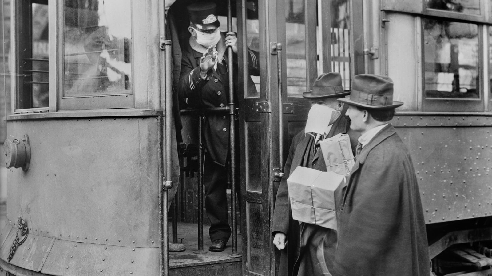 To slow the spread of the 1918 influenza pandemic, all street car riders were required to ...