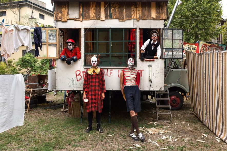 Manu, Lisa, Luca, and Maria of the Brunette Bros. pose for a portrait after their clown ...