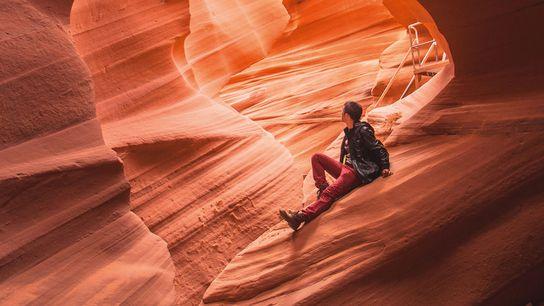 Man sitting on rock in Antelope Canyon