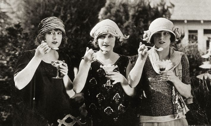 Triplets enjoy ice cream in 1920. The popularity of the frozen snack soared in Europe and ...