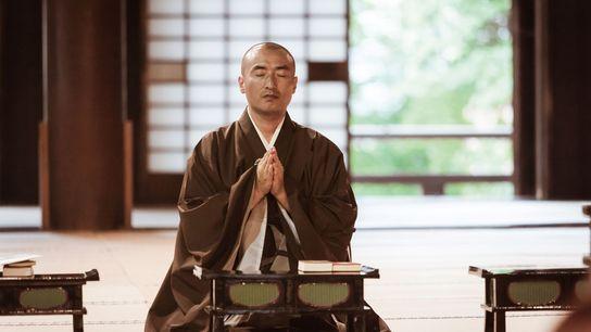 Buddhist monk praying inside a temple