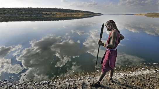 Maasai warrior on the shore of lake Magaddi