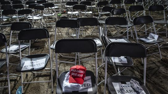"""A """"Make America Great Again"""" hat sits on a chair after a Trump campaign rally in ..."""