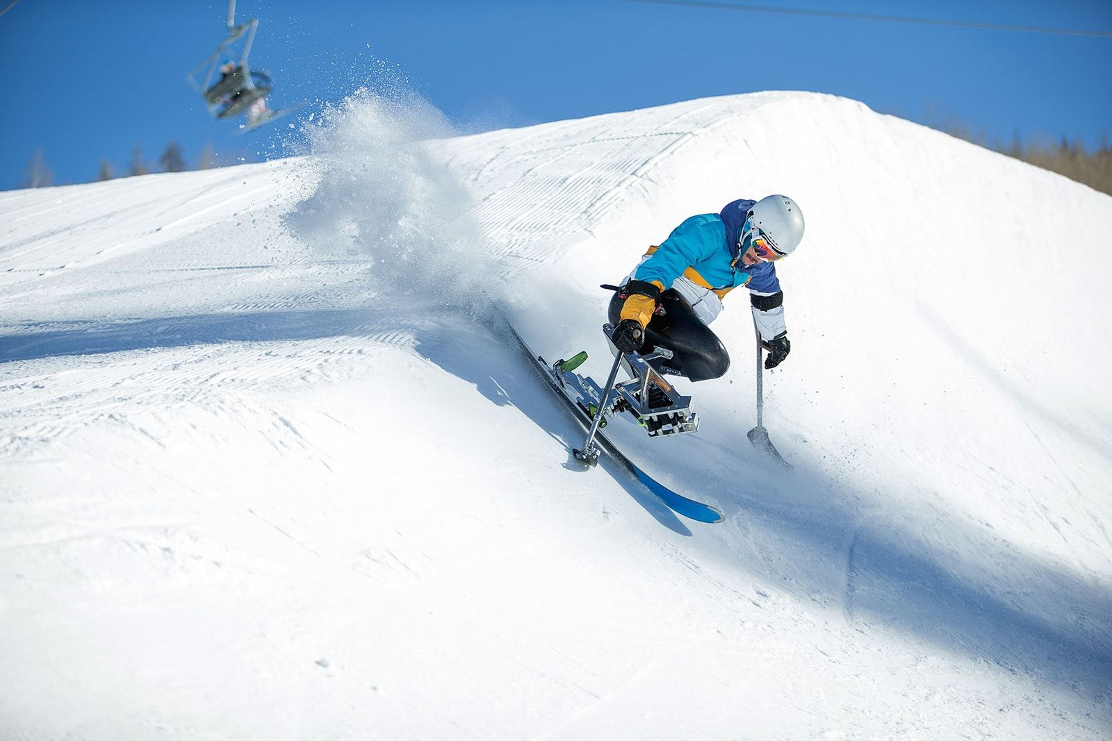 Accessible skier skiing down mountainside