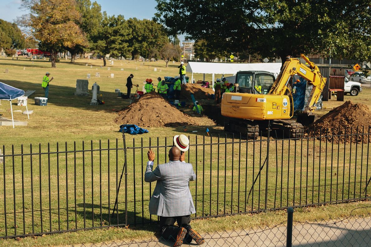 Reverend Robert Turner prays in front of an excavation site at Oaklawn Cemetery in Oklahoma, where ...