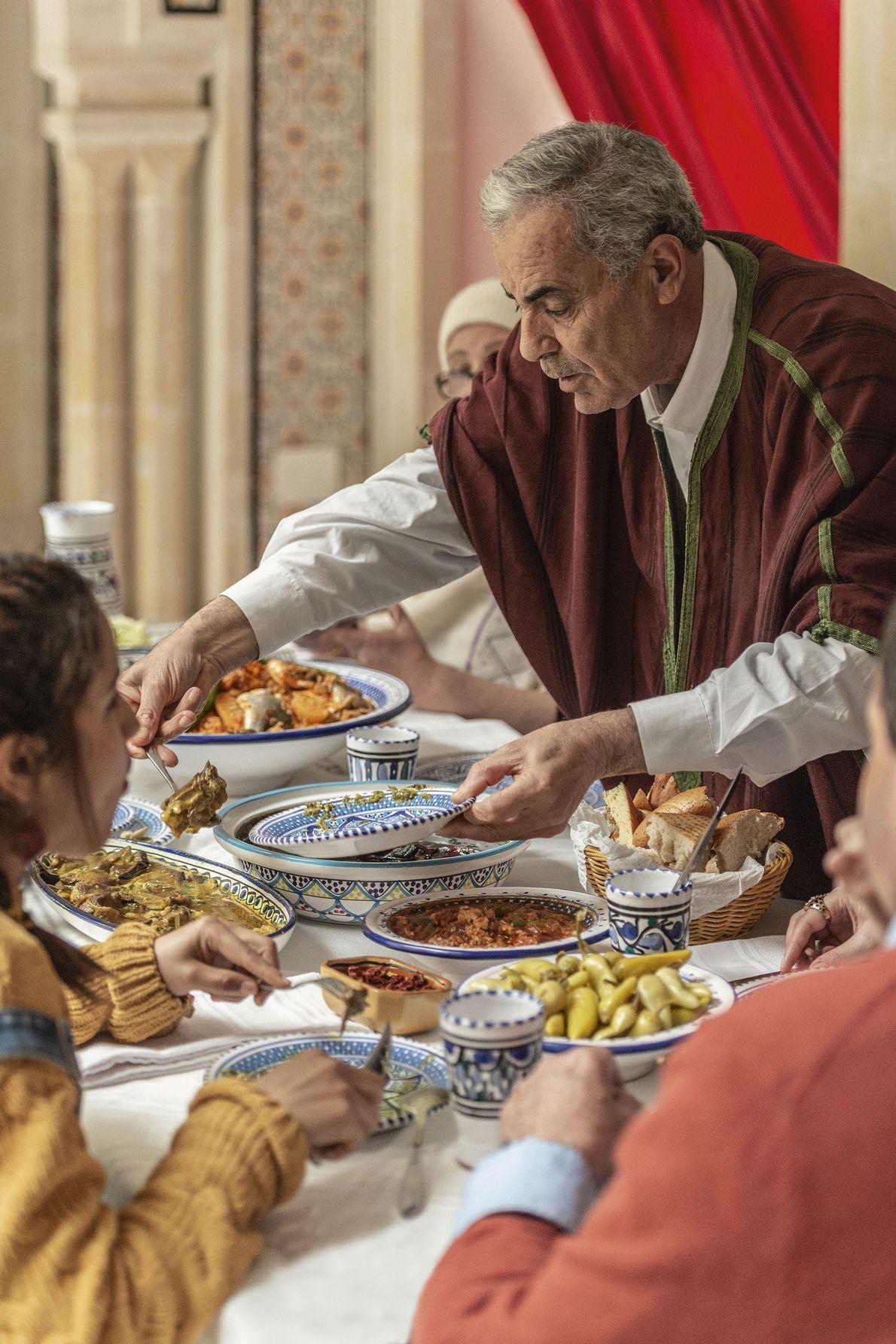 Salah loads his plate.