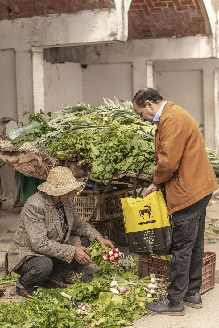 Rafik buying radishes at the market