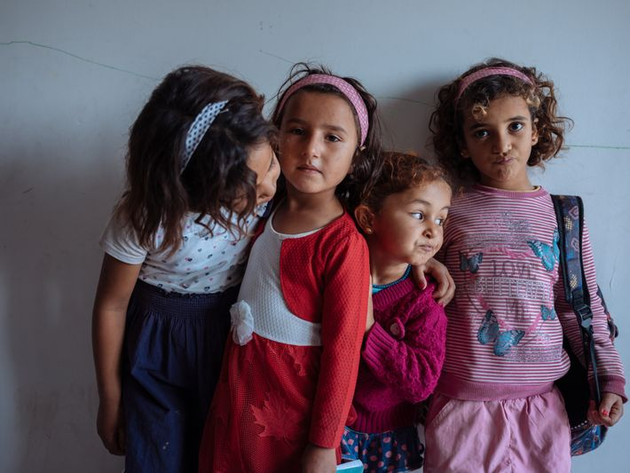 Syrian refugee children pose in their classroom. The school, run by Maya, a Turkish NGO, is ...