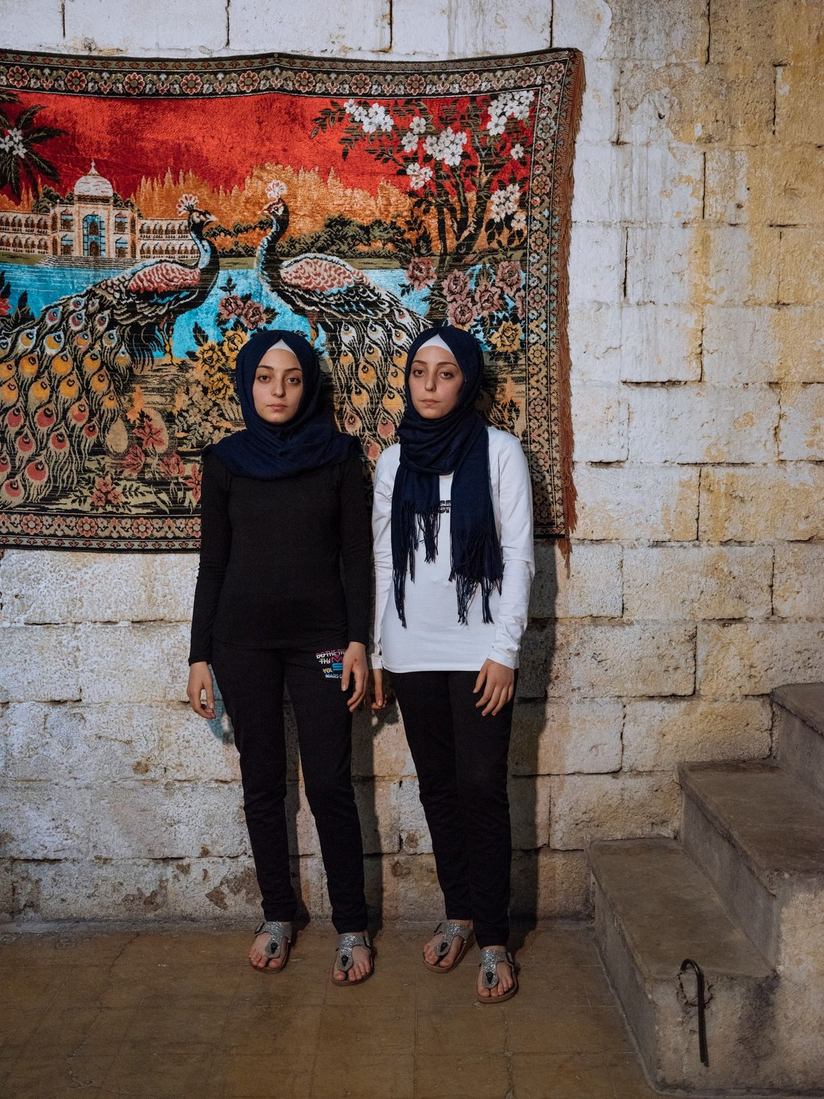 """""""Fourteen-year-old twins Sidra (at left) and Shahed remember the barrel bombs in Aleppo that forced them ..."""