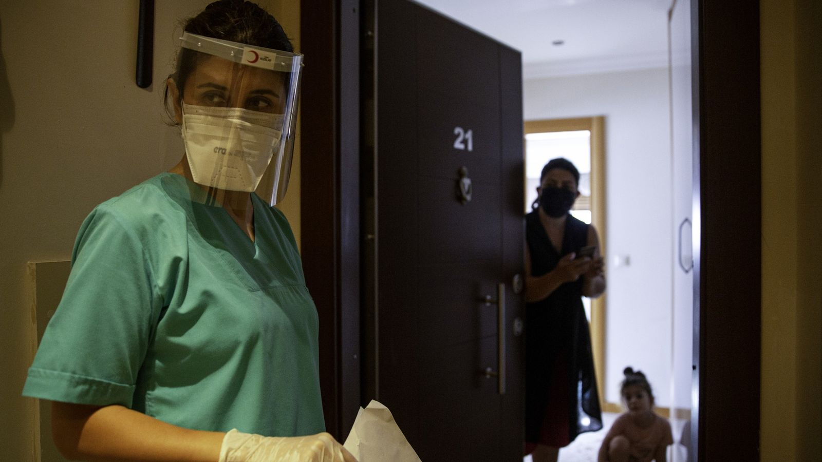Dr Gökçe Ünal, a dentist who has been reassigned as a contact tracer, is talking to ...