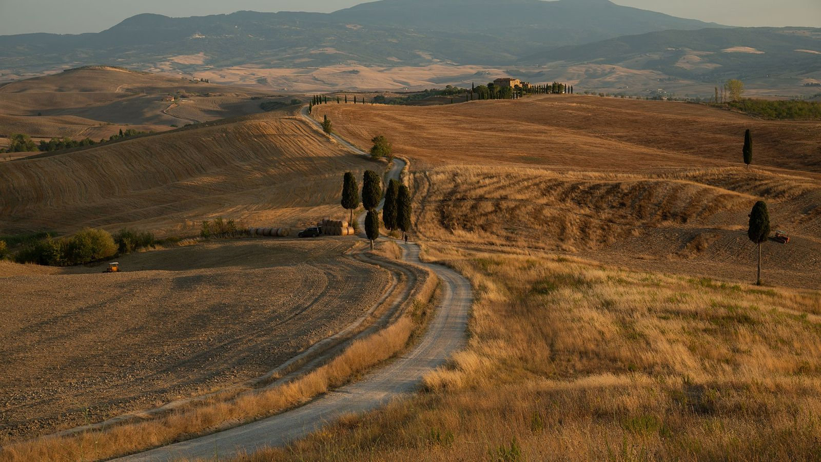 At day's end, sunlight gilds Tuscany's Val d'Orcia, a landscape that's been depicted in Renaissance art ...