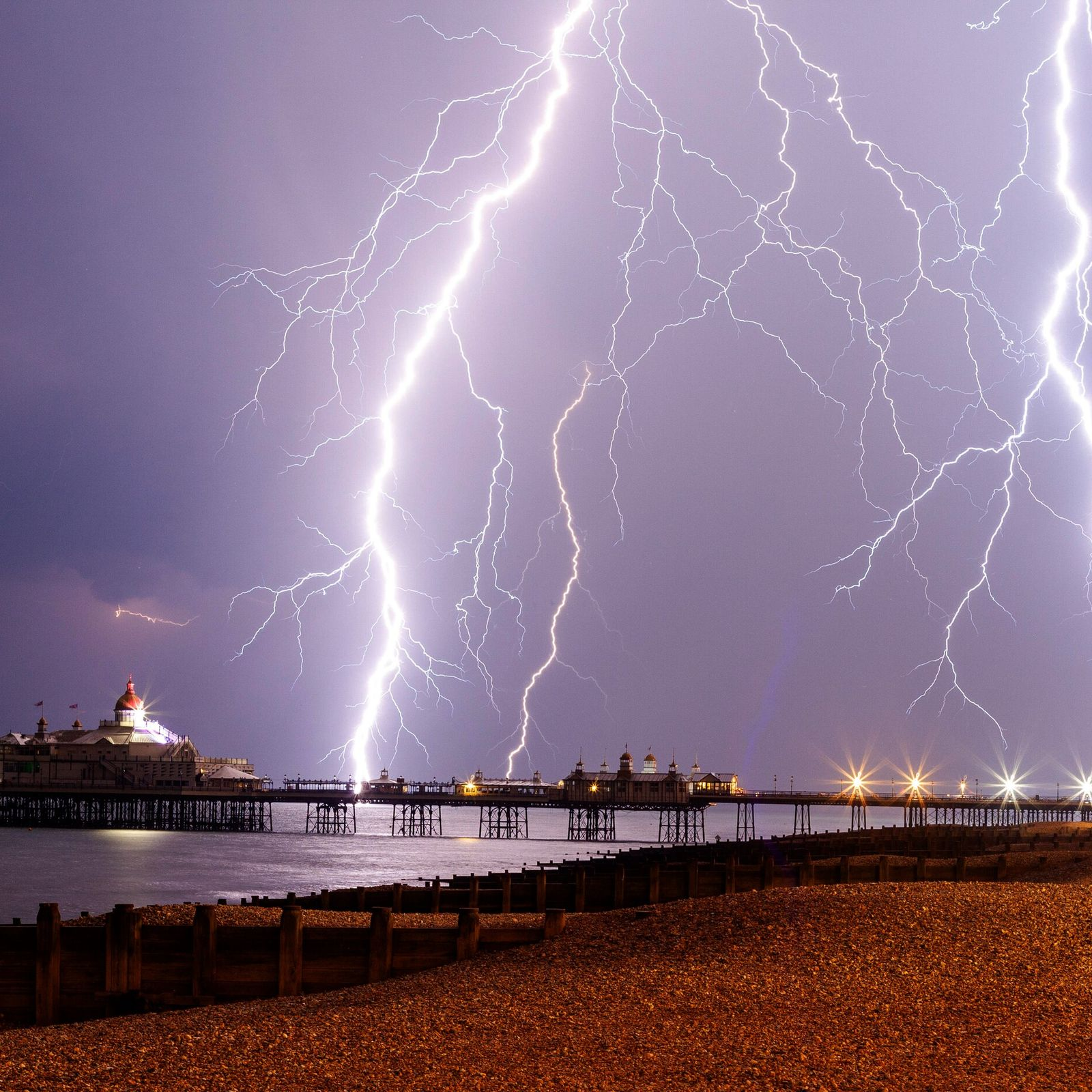 Eastbourne Pier, Essex, takes the brunt of a lightning storm in June 2019 which saw some 1,000 ...