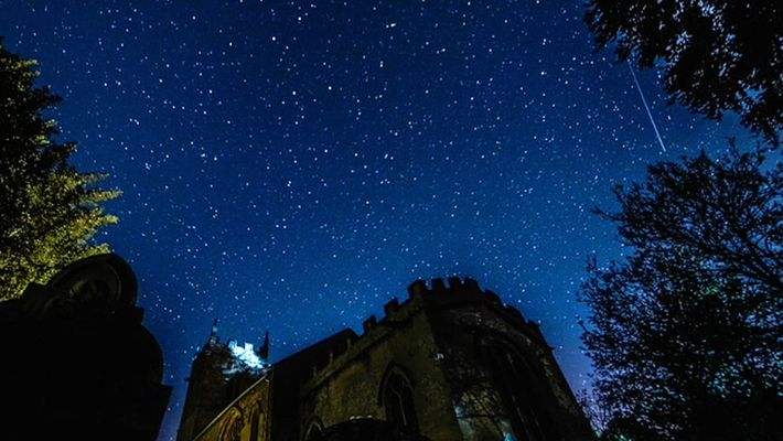 Meteors From Halley's Comet Fly Over a Medieval Church