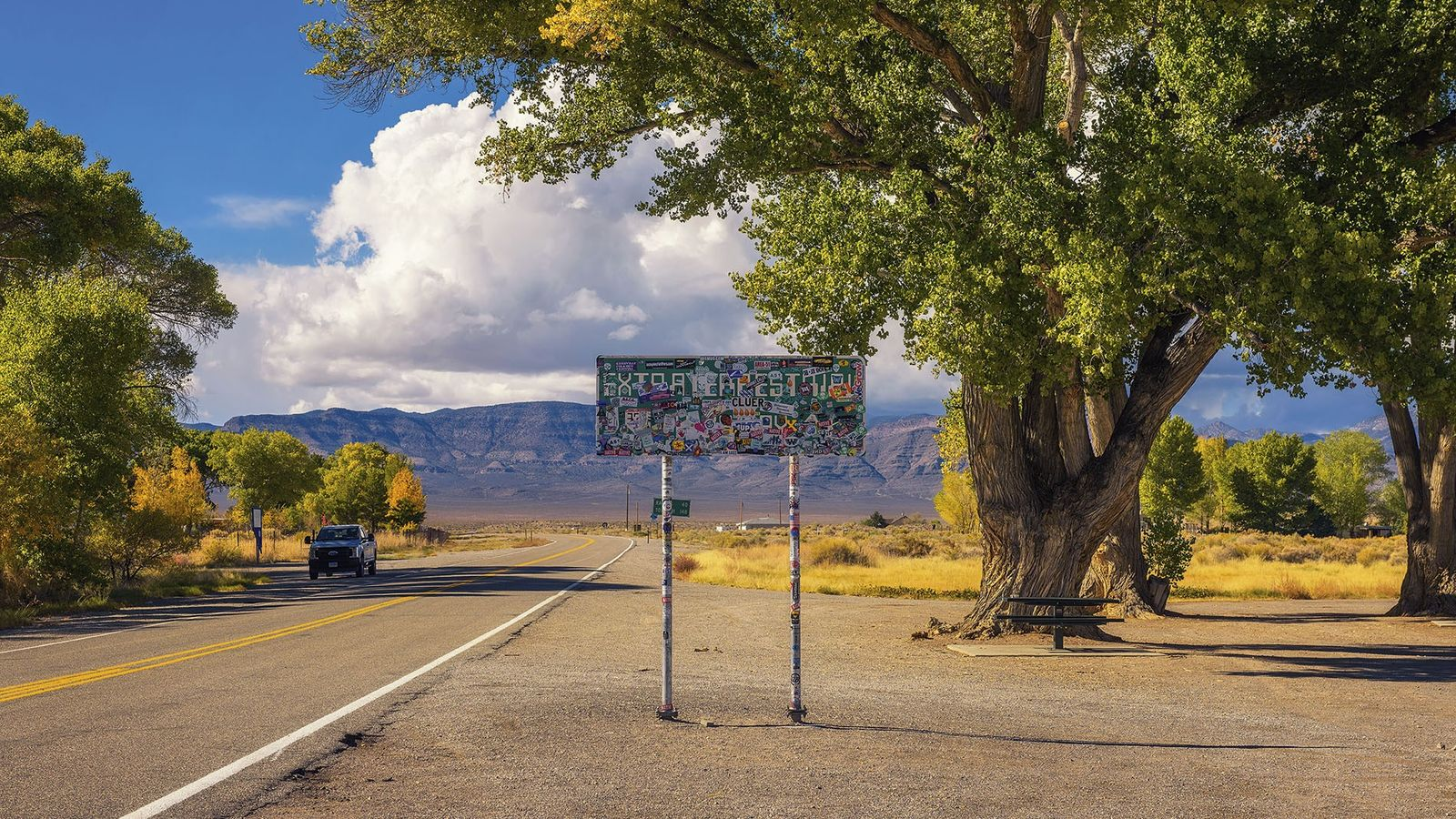 Sign reading 'Extra Terrestrials' beside a highway in Crystal Springs, Nevada.