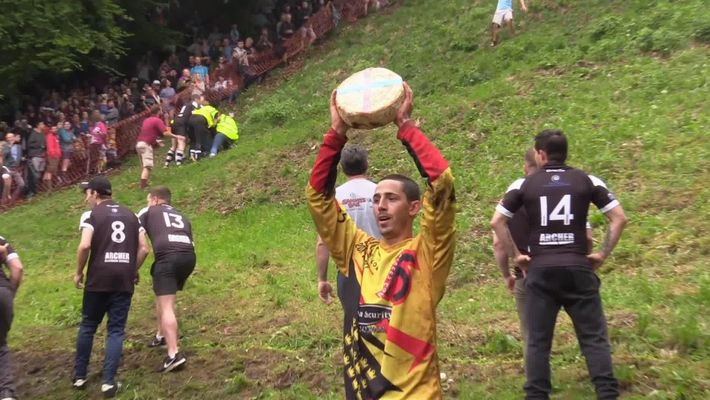 Watch a Downhill Cheese-Chasing Competition in Britain