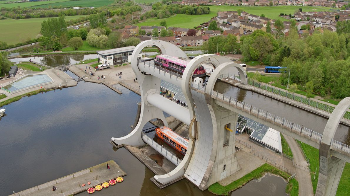 A barge at the top of the Falkirk Wheel, a boat lift that connects two canals ...