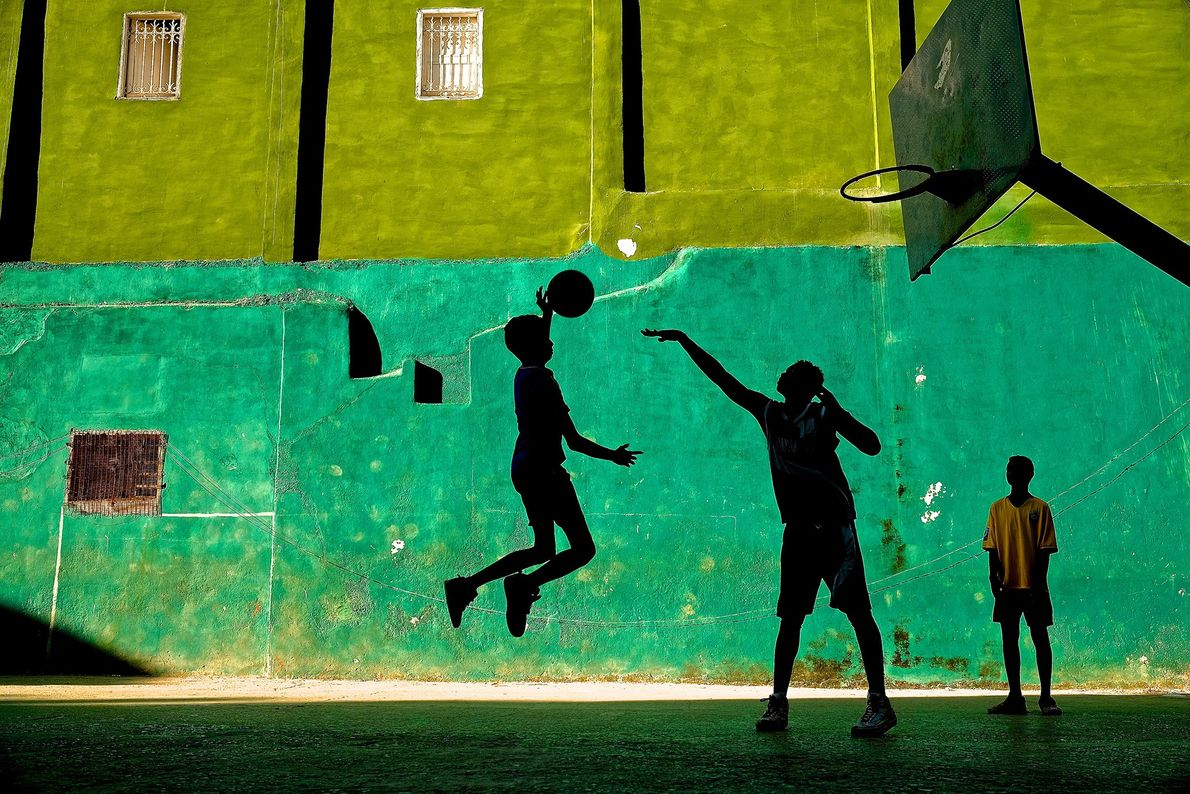 Young boys play basketball after school in a Havana neighbourhood.