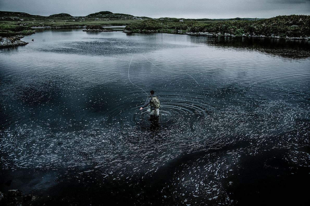 James Anderson fishes in the protected area of Loch Langabhat, the most extensive body of freshwater ...