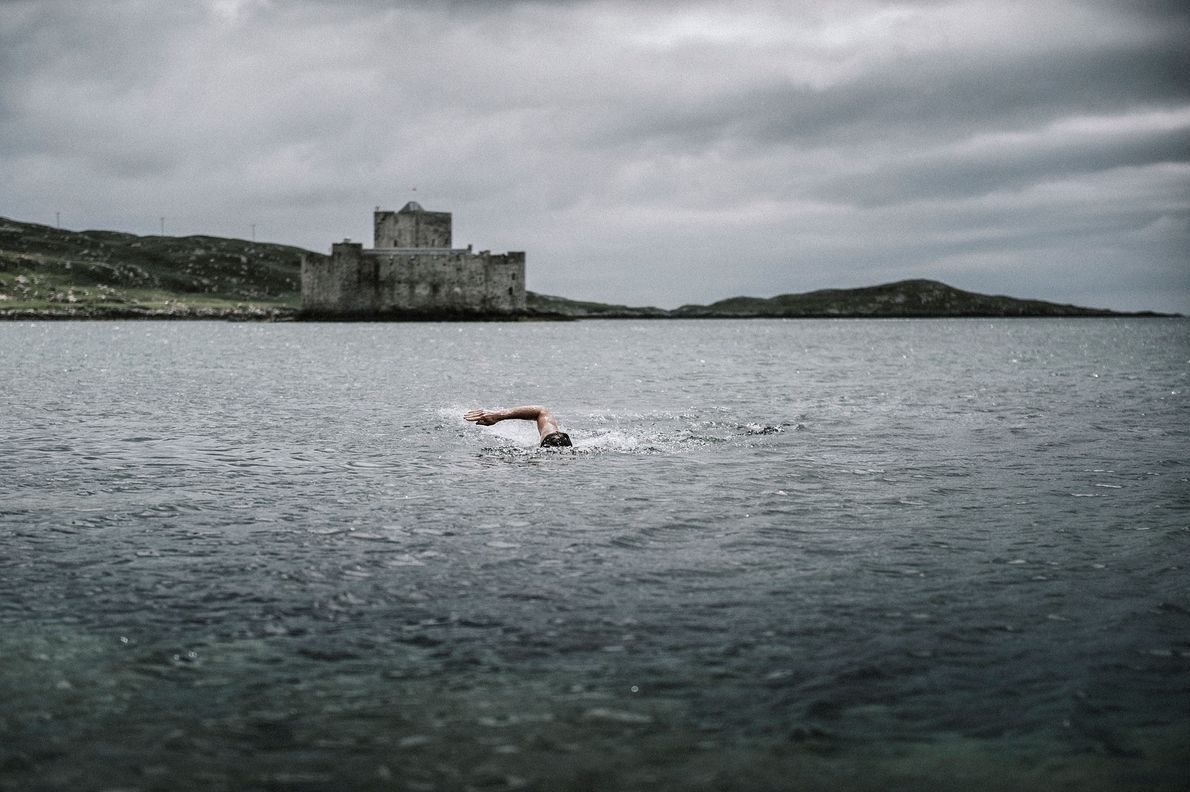 After a marathon, Angus swims between the coast and Kisimul Castle on the Isle of Barra.