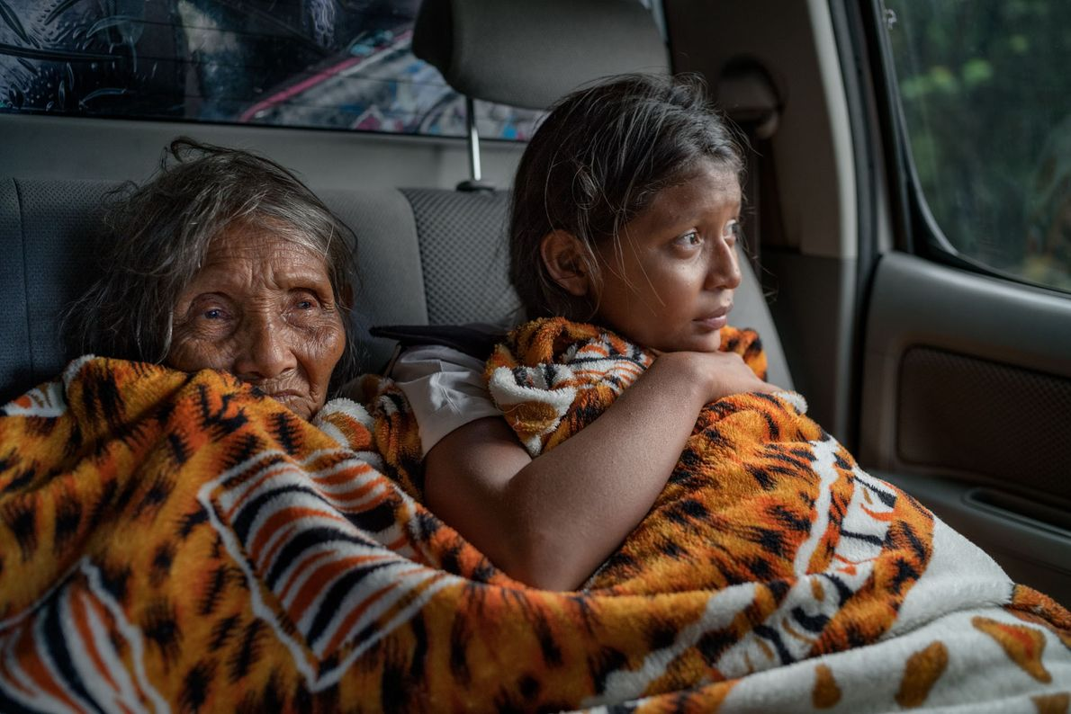 Grandmother Delia Estrella and Ingrid Moraleda, 13, ride from Las Claritas to Santa Elena with their ...
