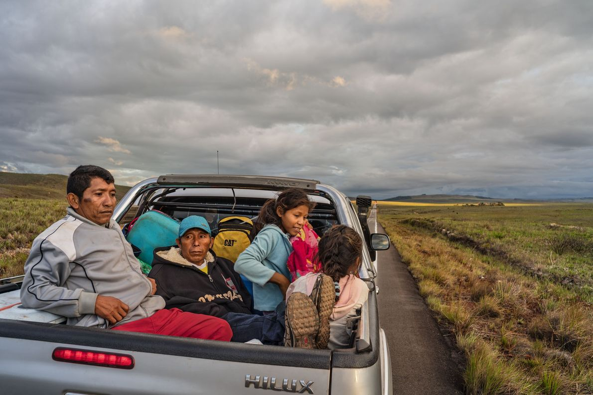 Moraleda family members ride in the back of a pickup after leaving their Orinoco Delta home …