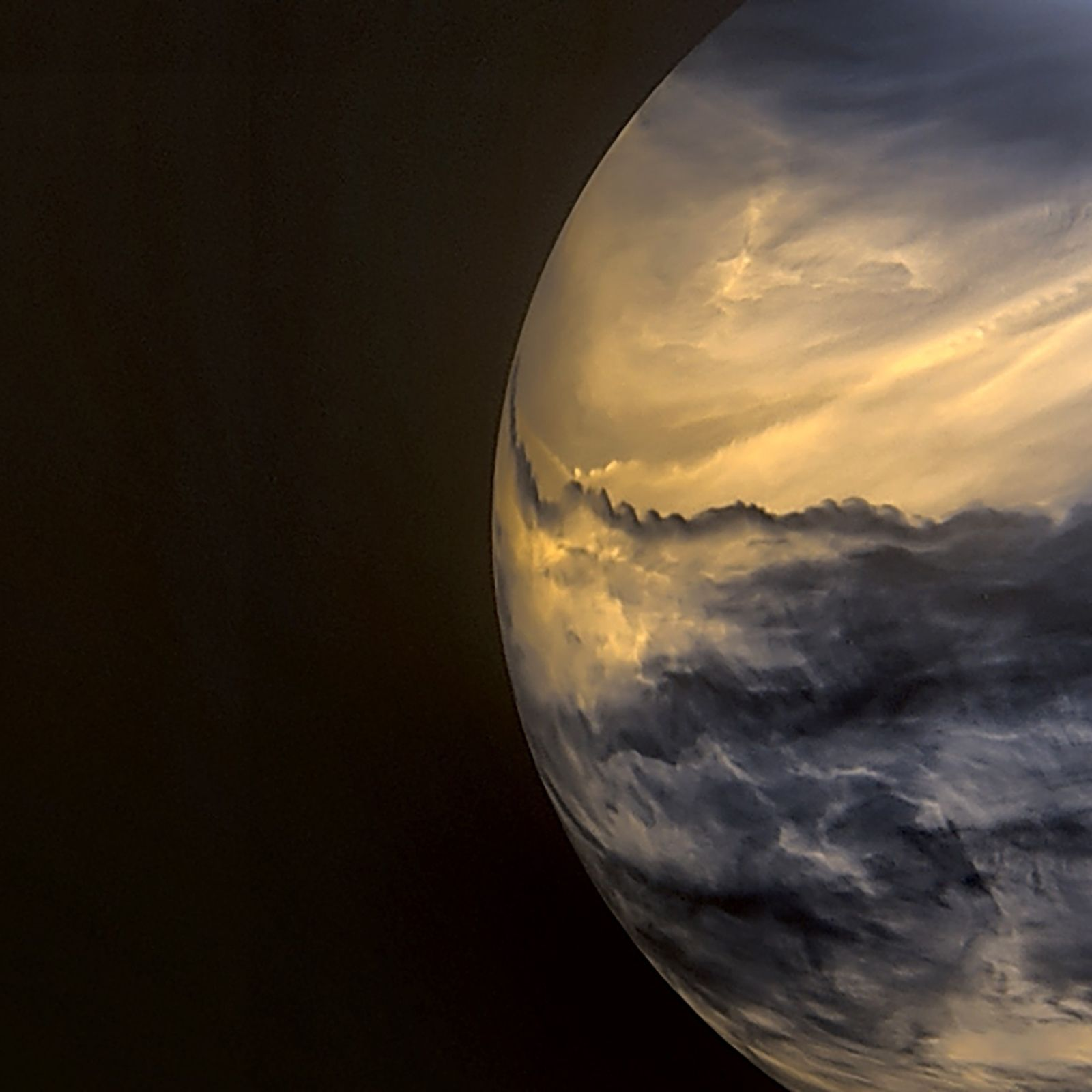 Dark higher-altitude clouds obscure the brighter mid-altitude clouds in this image of Venus taken by an ...