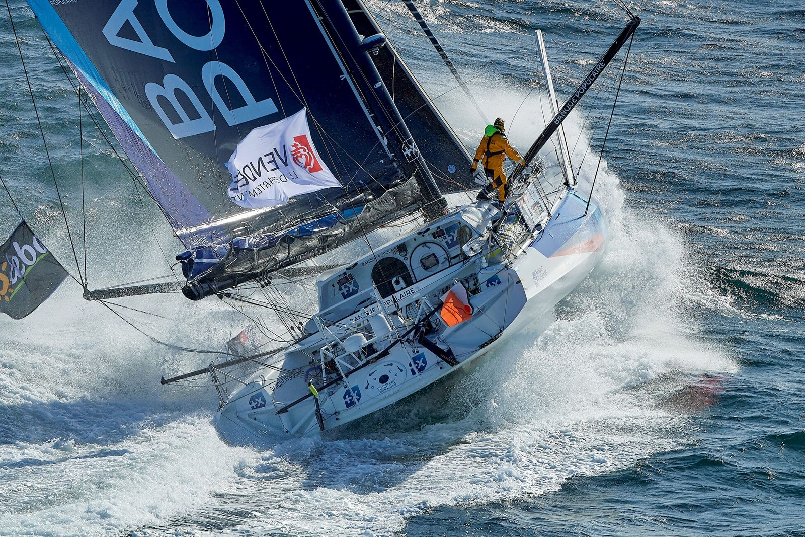 Clarisse Crémer, 30, on Banque Populaire X tacks across a wave. In the Vendée Globe, skippers ...