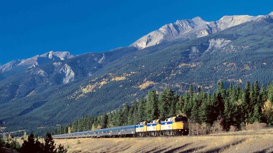 A Via Rail train carries travellers through the scenic Canadian Rockies.