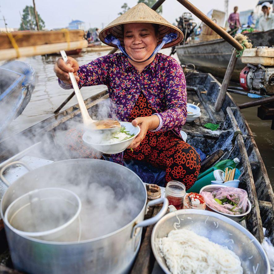 Pho bo noodle soup at a floating market on the Mekong River Delta.