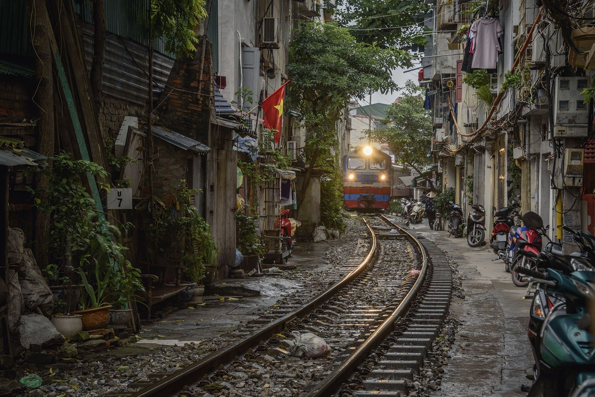 The the Reunification Express passes through Hanoi's Old Quarter.