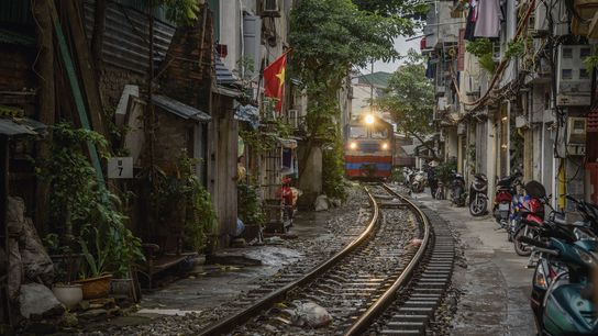 The the Reunification Express passes through Hanoi's Old Quarter