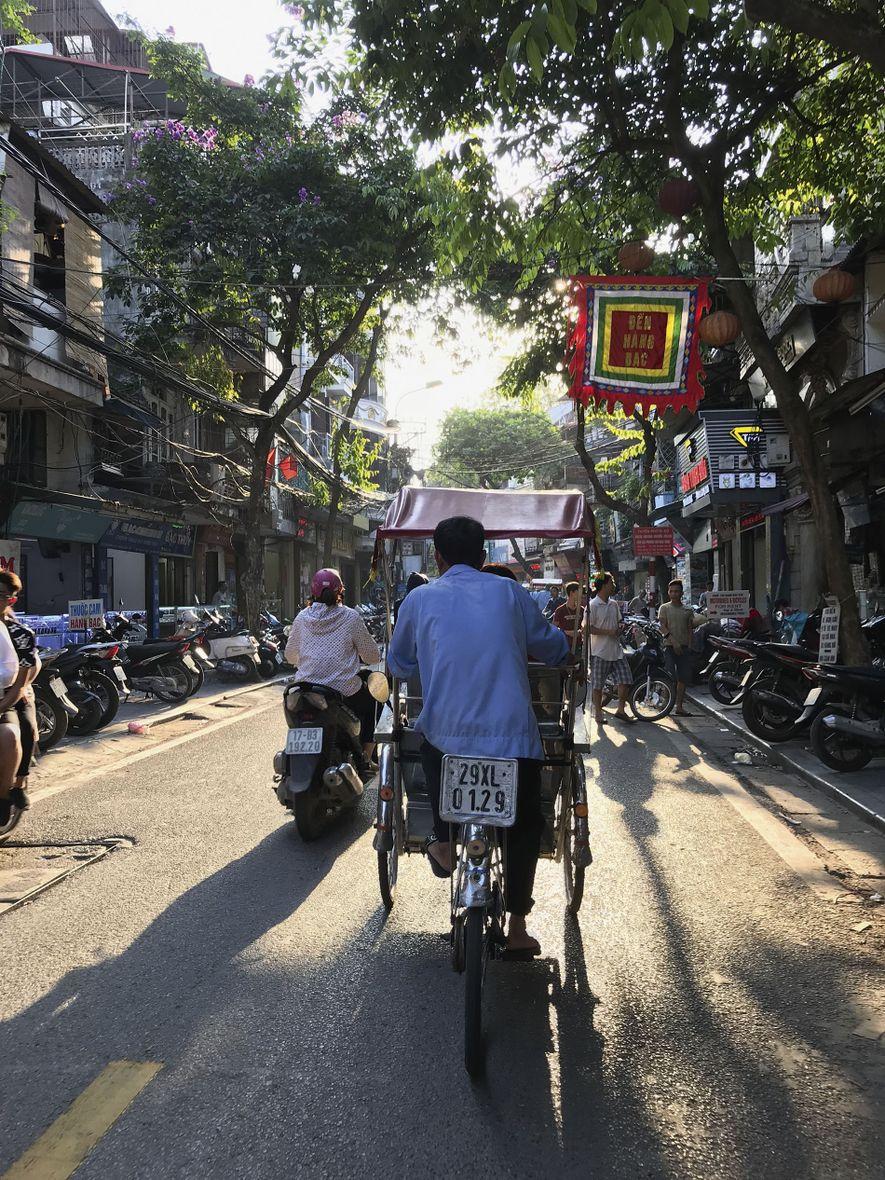 Exploring Hanoi's Old Quarter via cyclo.