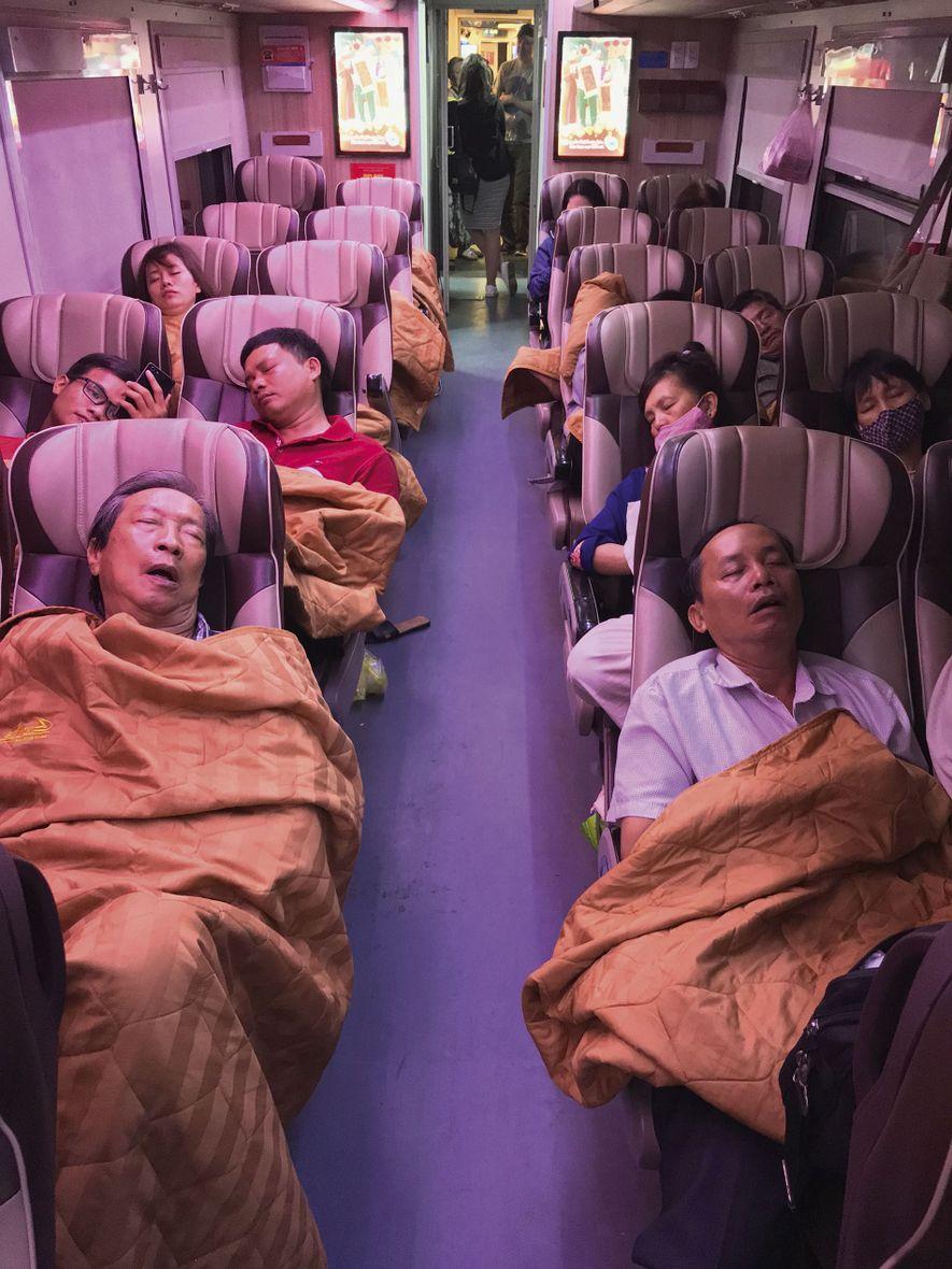 Passengers asleep aboard the Reunification Express.