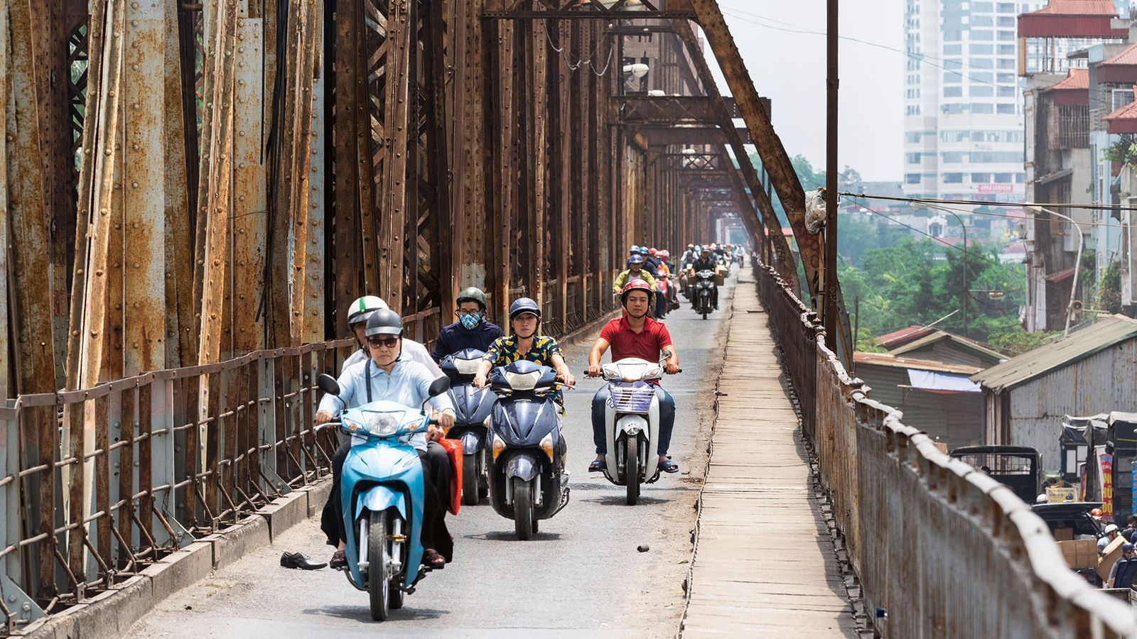 Scooters crossing Long Bien Bridge, Hanoi
